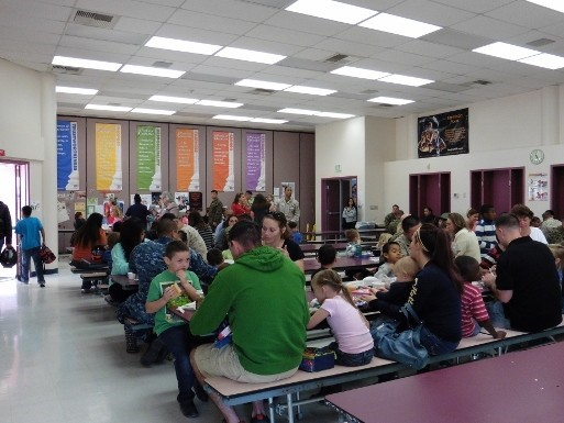 Lunch room with parents and their children
