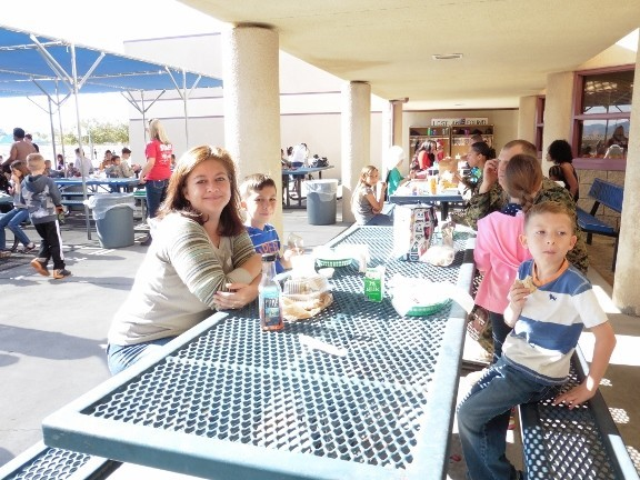 Parents eating lunch with their child