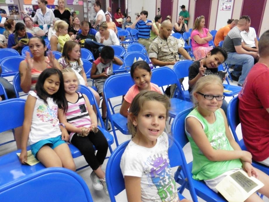 Seussical Jr assembly audience watching the show