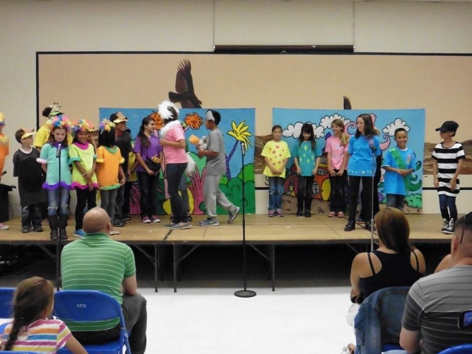 Seussical Jr assembly performers on the stage