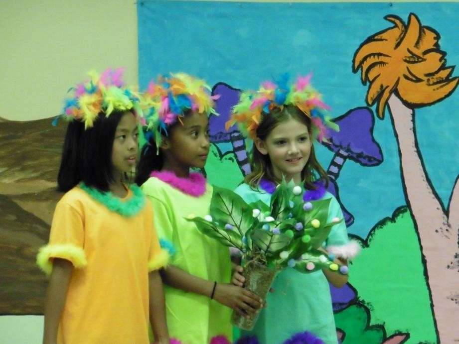 Seussical Jr assembly student on stage