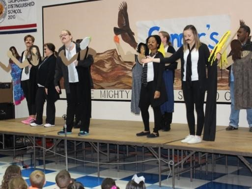 Staff as Artist assembly.  Staff on stage