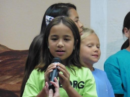 Student at School House Rocks assembly