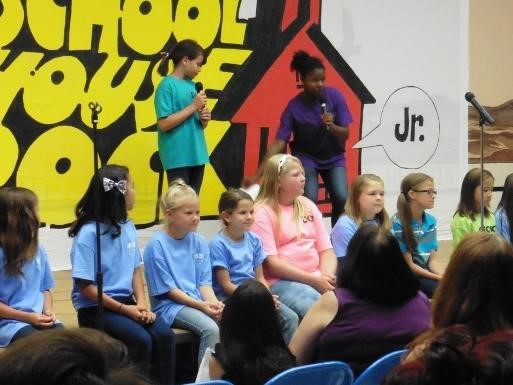 Students on stage for School House Rocks assembly