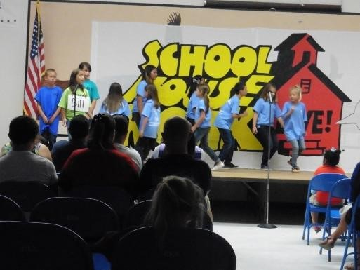 Students on stage for School House Rocks assembly doing a skit