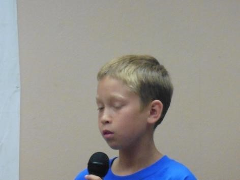 Student speaking on stage for School House Rocks assembly