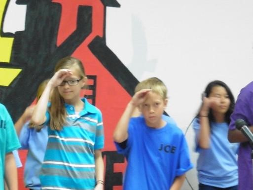 Students saluting for School House Rocks