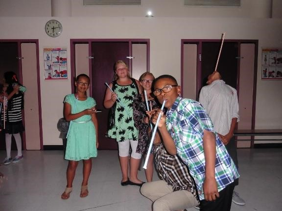 Students at 6th grade dance with pixy stix candy