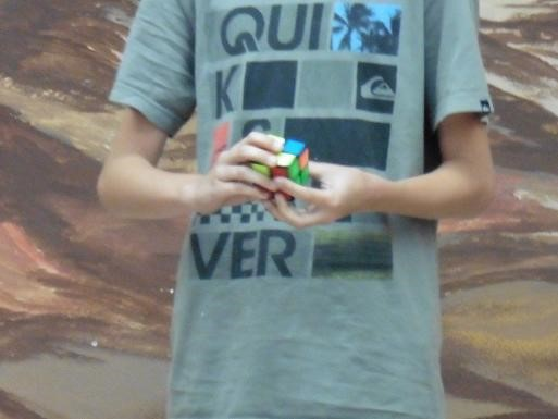 Student as Artists students doing Rubik's cube