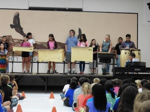 Students playing instruments on stage