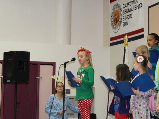 Students on stage at the Winter Celebration Assembly
