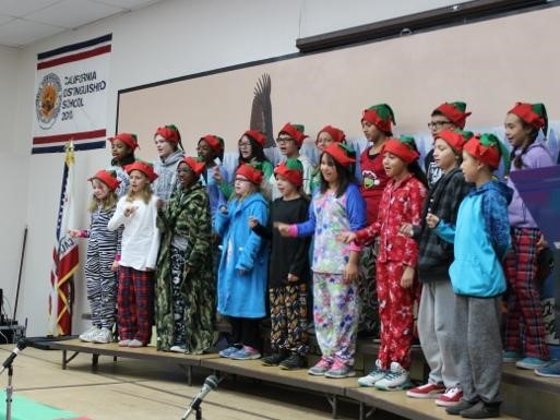 Students singing at the Winter Celebration Assembly