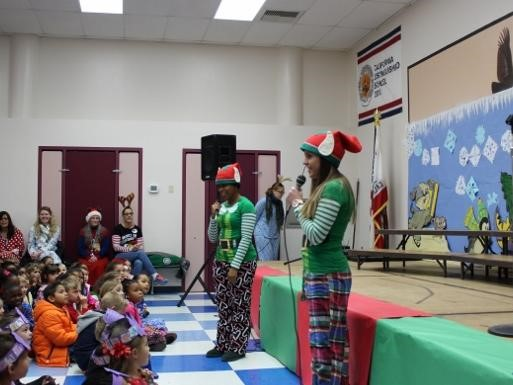 Staff dressed as elves talking to students