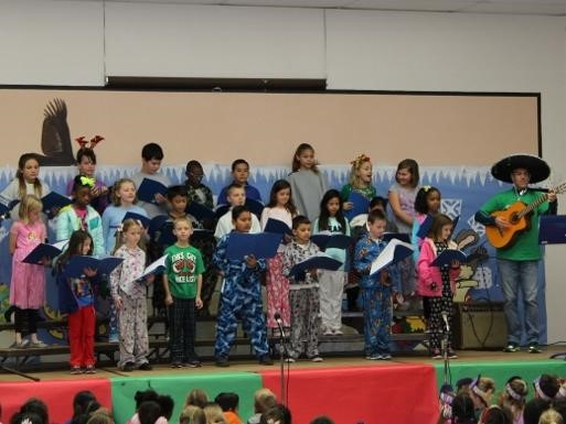 Students on stage singing