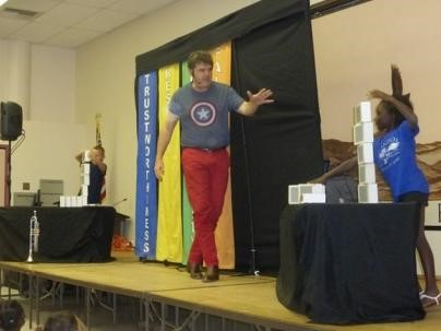 Teacher on stage at the Character Counts Assembly