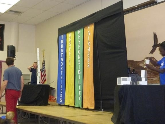 Four banners at the Character Counts Assembly