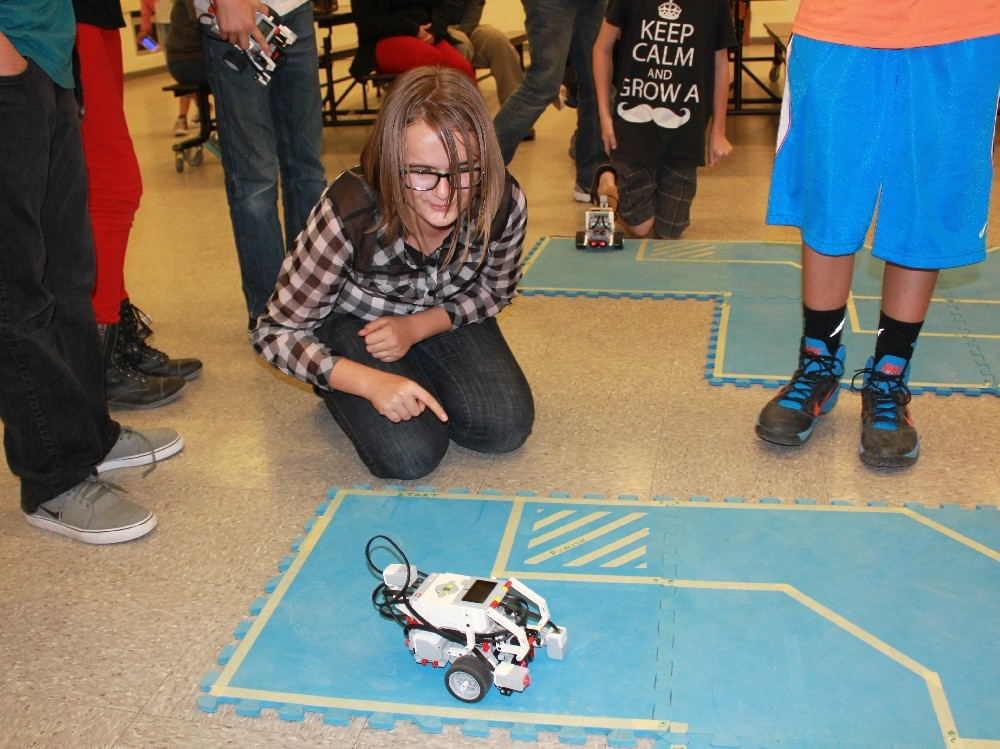 Student working with robotics