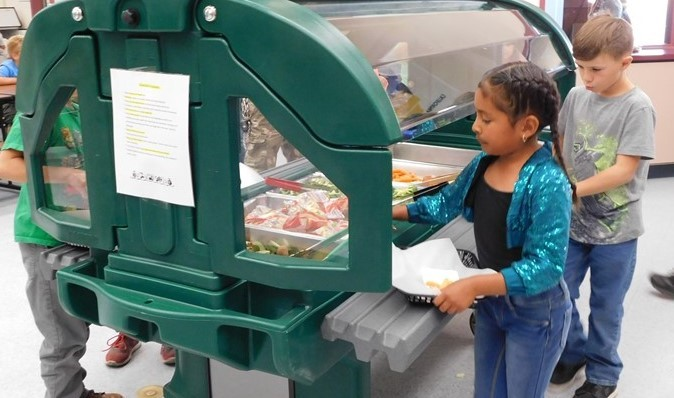 Students make selections from the salad bar