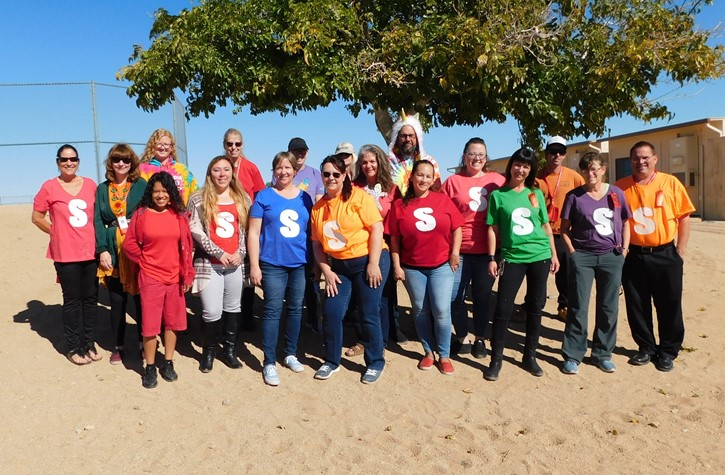 Staff dress in rainbow colors for Red Ribbon Week
