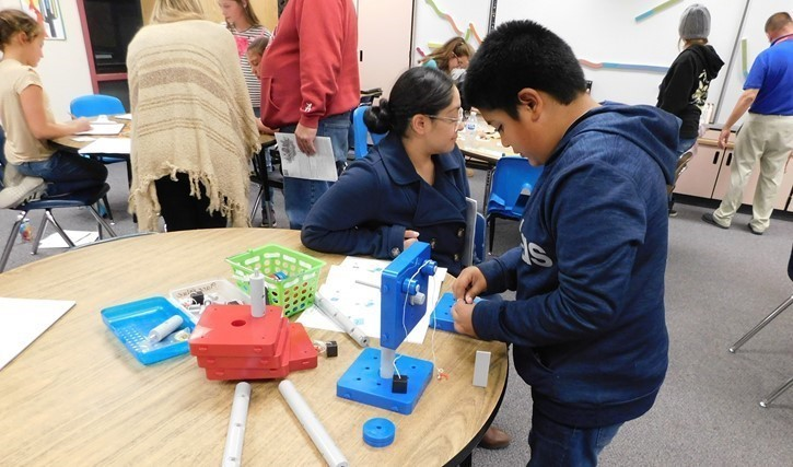 Students learn about engineering at the LES STEAM Night