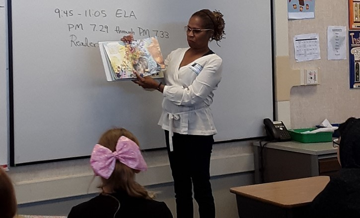 lady reading to class