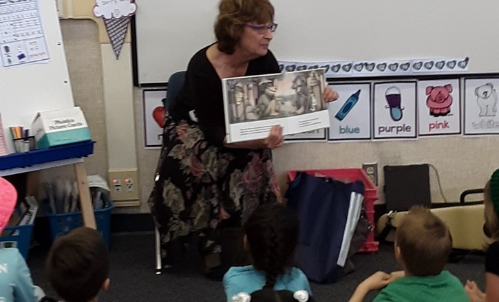 Older lady reads to children