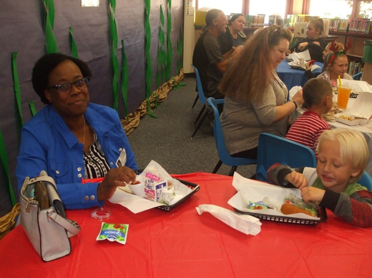Students enjoy lunch with their grandparents
