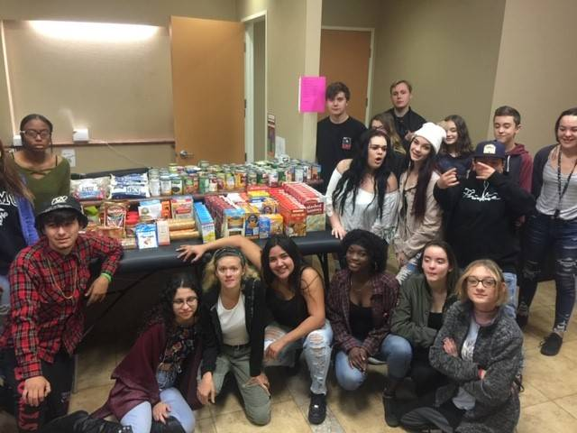 Students with food collected for food drive.