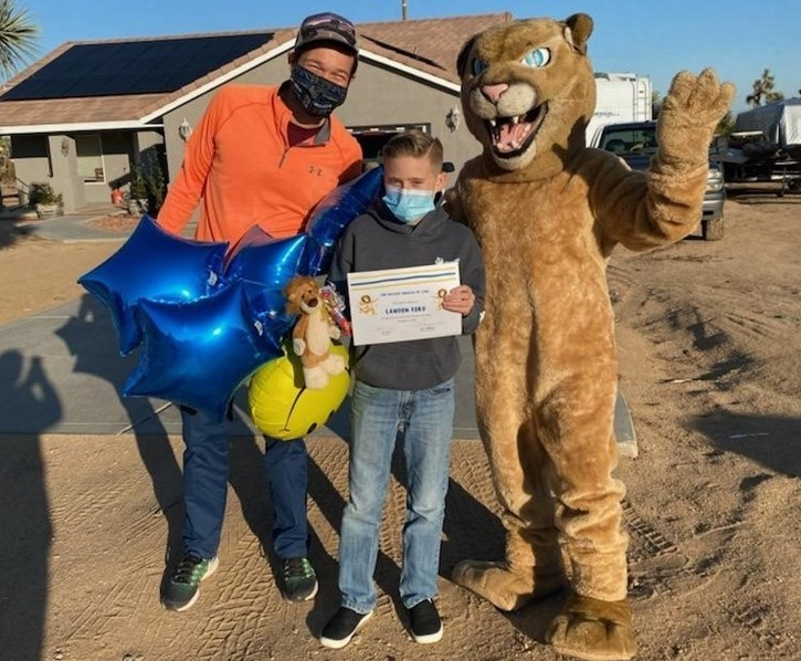 Landon Ford, winner of last weeks Masked Singer Competition,  gets a visit from Mr. Gates and the LCMS Lion