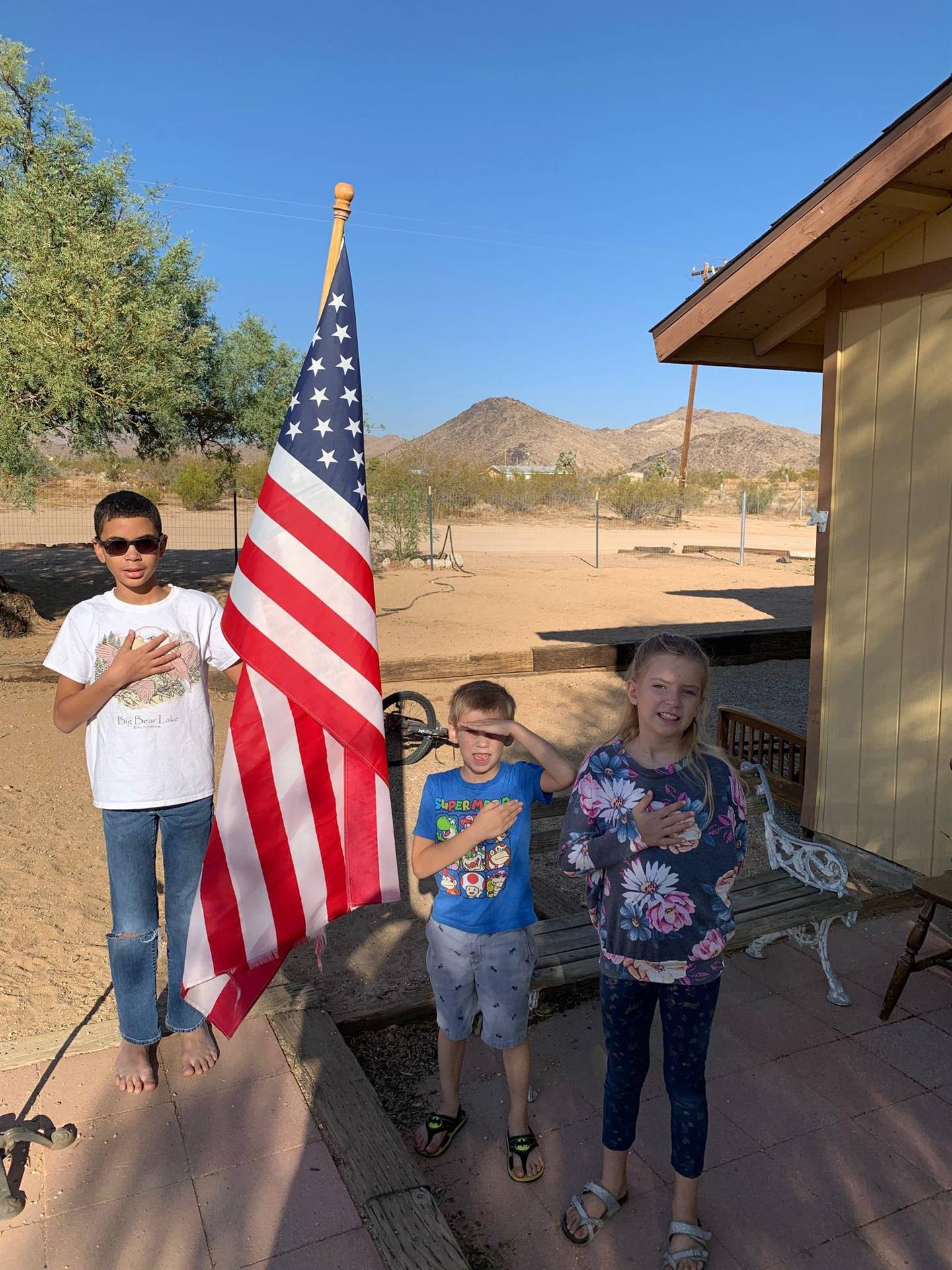 LES students say the Pledge of Allegiance from home