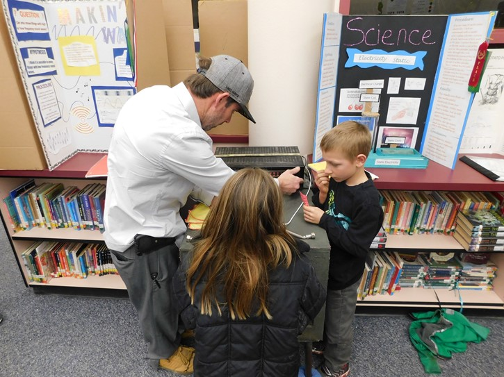 Mr. Mike assists students at the LES 2020 Science Fair