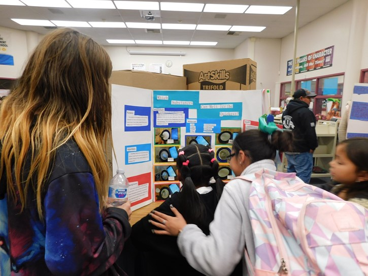 Students observe and learn from the science projects done by their peers