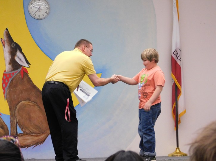 Principal Mr. Lowe presents a student with an award at the Jan. 31 Award Ceremony