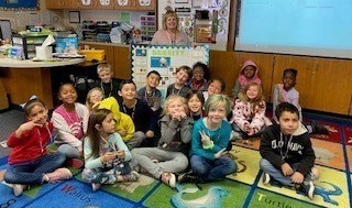 Principal in classroom with students