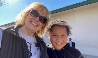 Principal and student outside in the sun