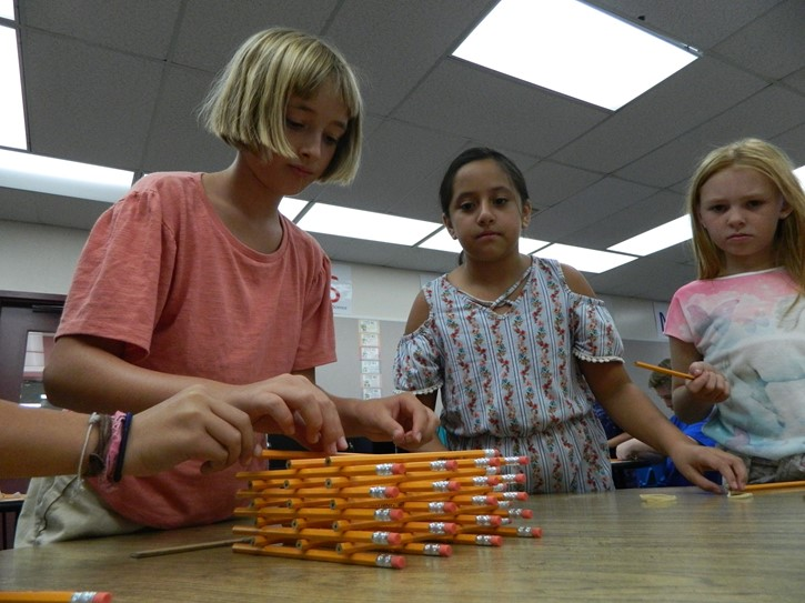 Students work together in the STEAM lab