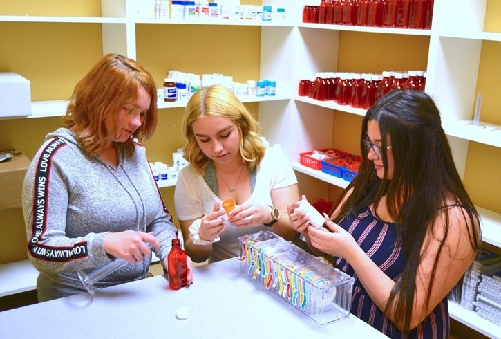 Students Reading Pharmacy Labels