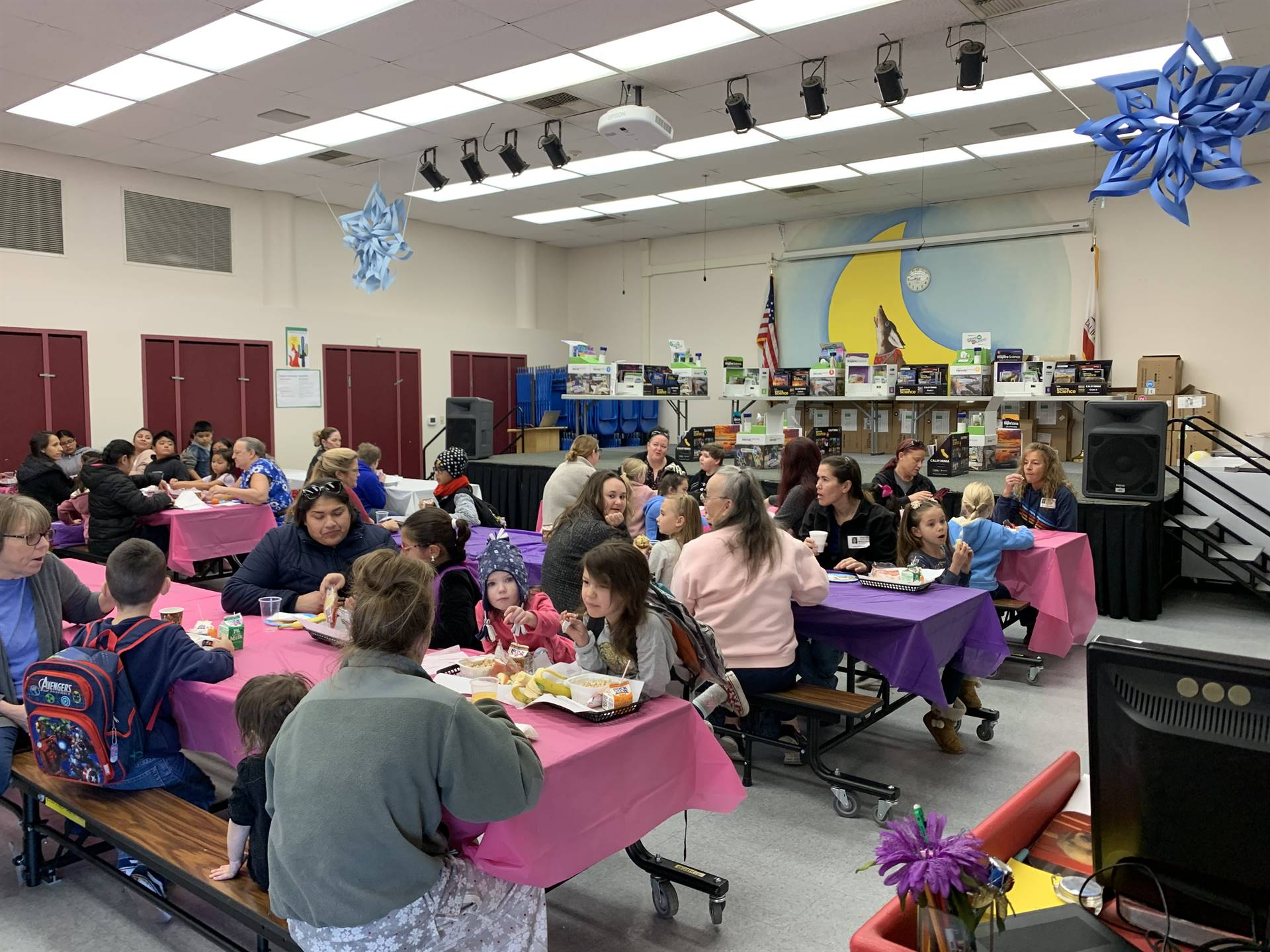 Moms and students gather for Muffins for Moms at LES