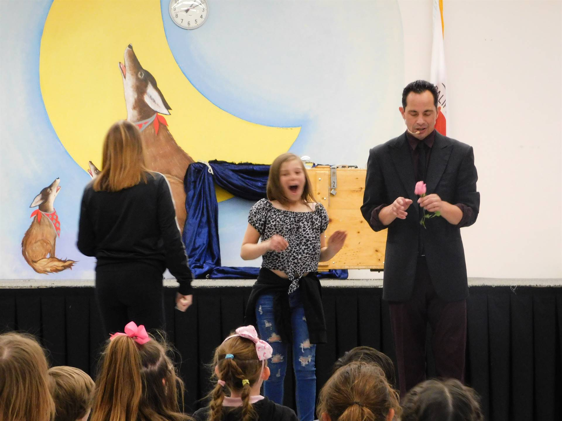 A student is amazed my a magic trick at the LES magic show