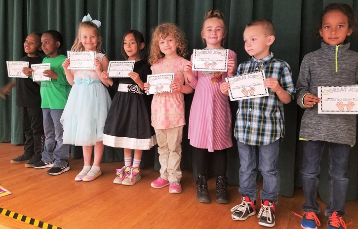 Kindergarten students receiving awards