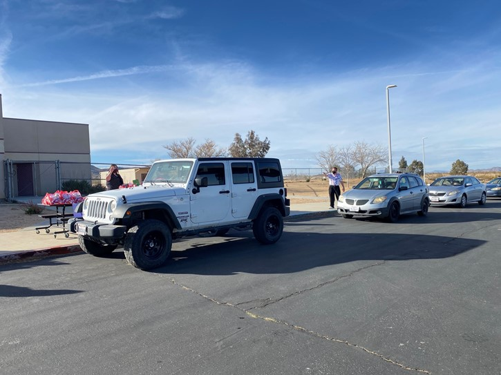 Cars line up for the Valentine's Day pickup