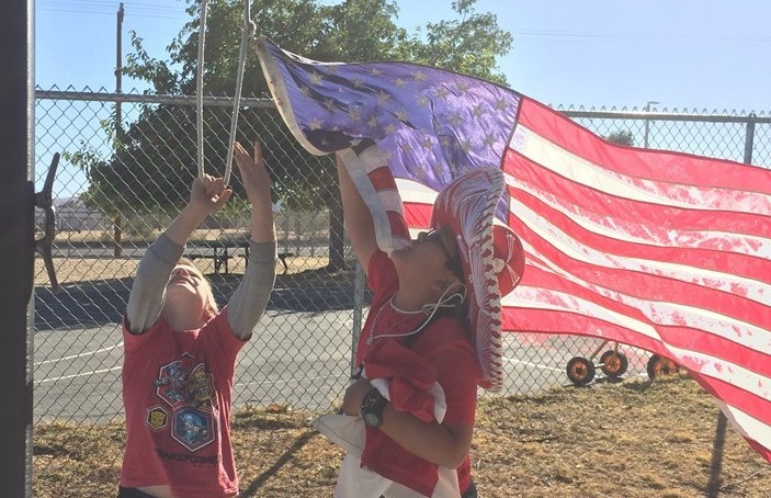 Coyote Council members lower the American flag at the end of the school day