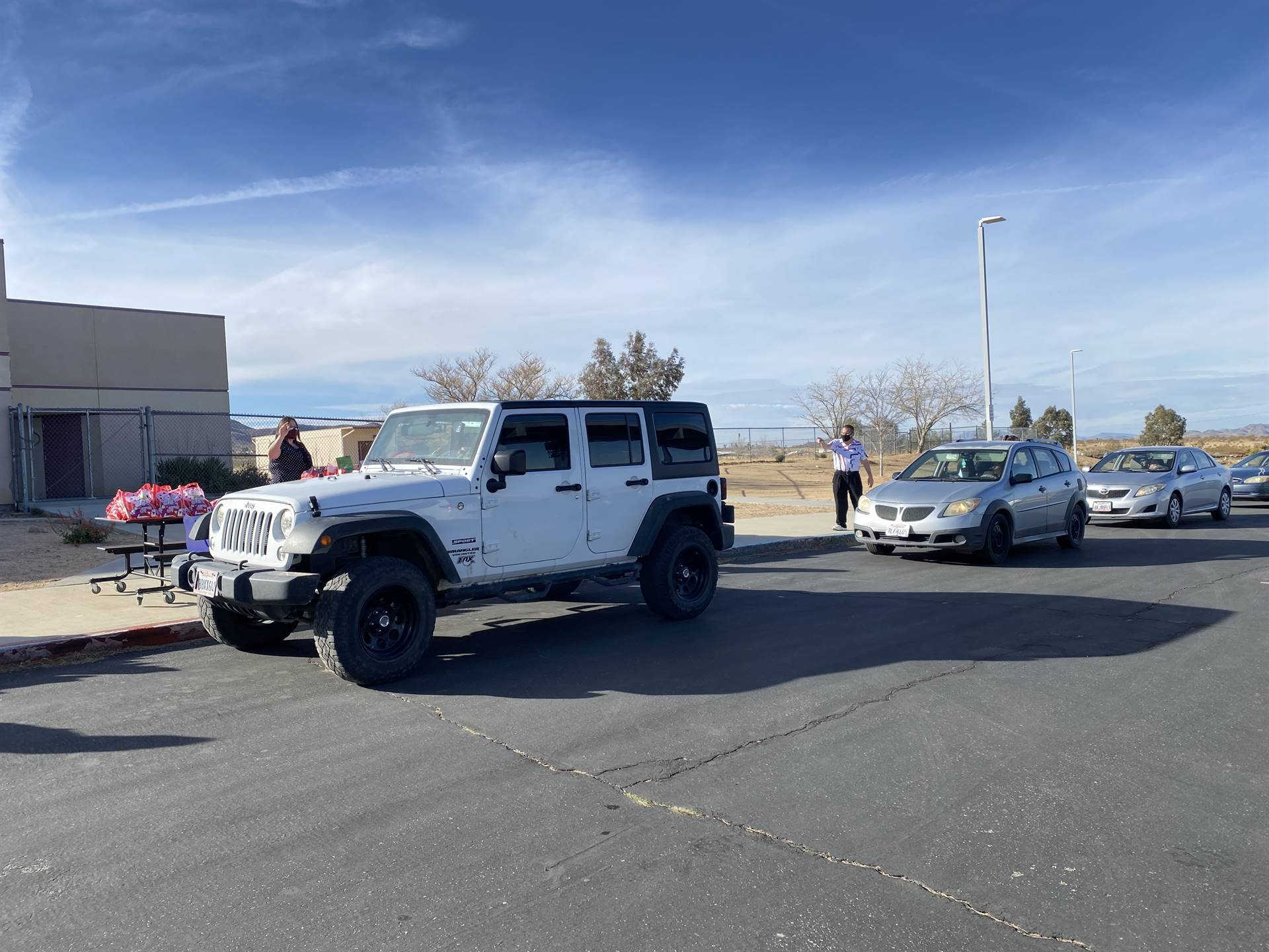 Cars line up for Valentine's Day pickup