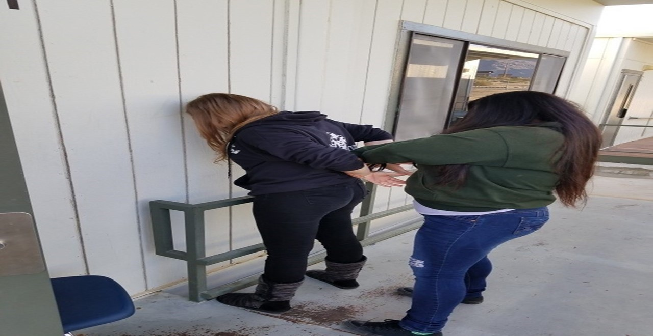 Students in Security making an arrest