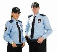 Male and Female security guards standing in uniform